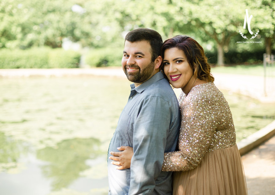An engaged couple smiling at Centennial Park in Nashville, Tennessee