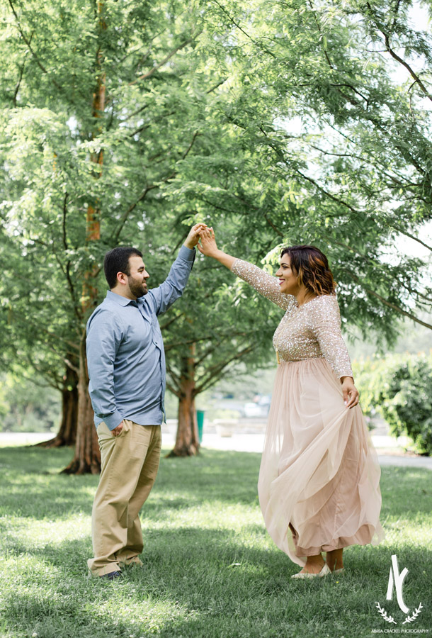 A twirling dance picture of an engaged couple at Centennial Park in Nashville TN