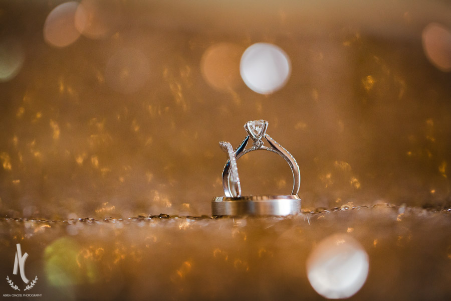 Wedding rings on a sparkling bed of sequins