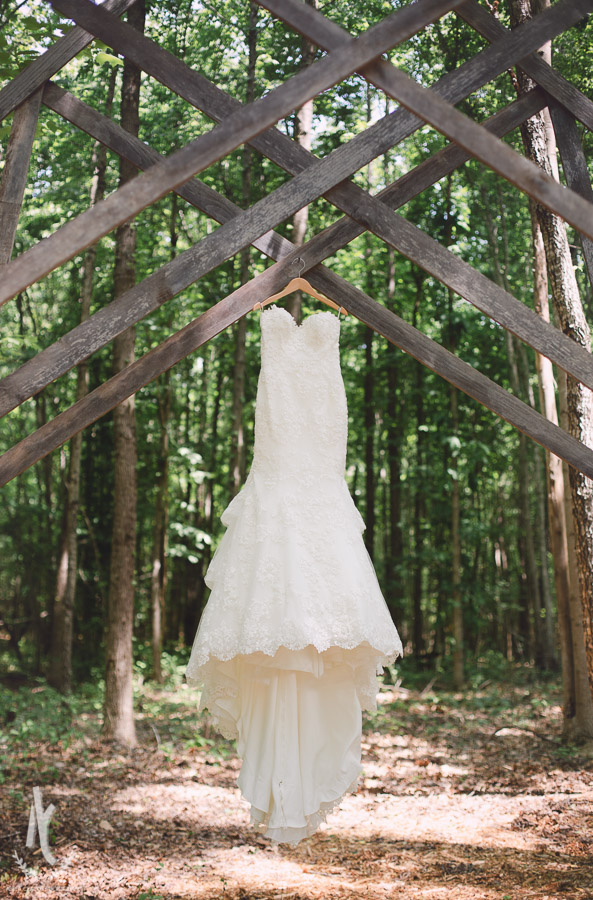 Wedding Dress hanging under the trees