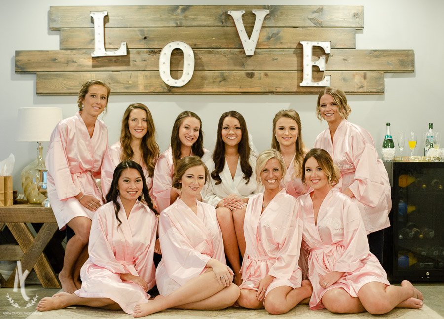 Bridesmaids and bride with monogrammed pink robes