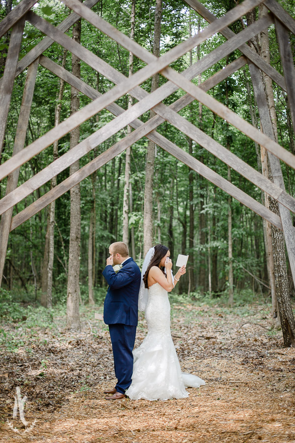 Bride and groom wipe away tears before their first look