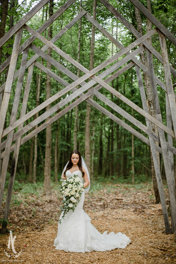 Bride under geometric awning in woods