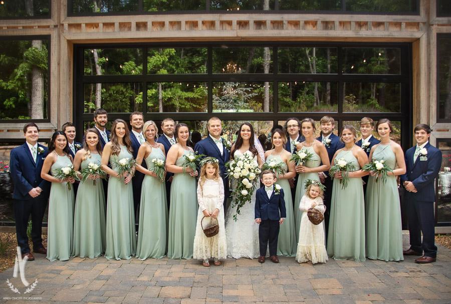 Wedding party in front of industrial doors