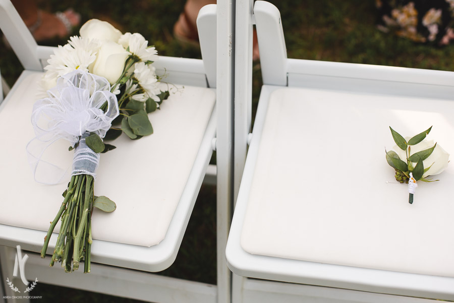 Groom honoring parents who passed away with florals
