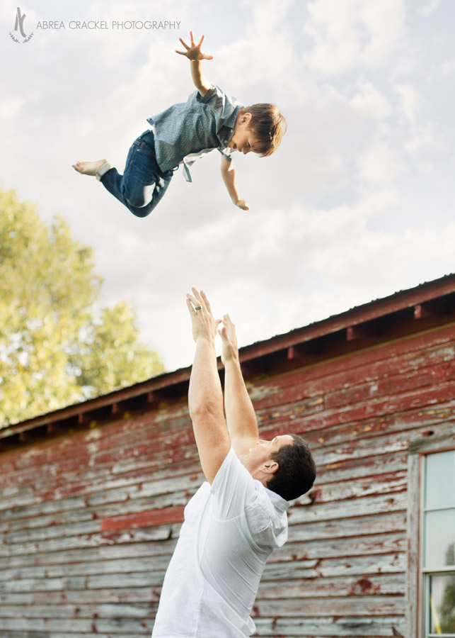 Dad throws toddler in the air to catch him