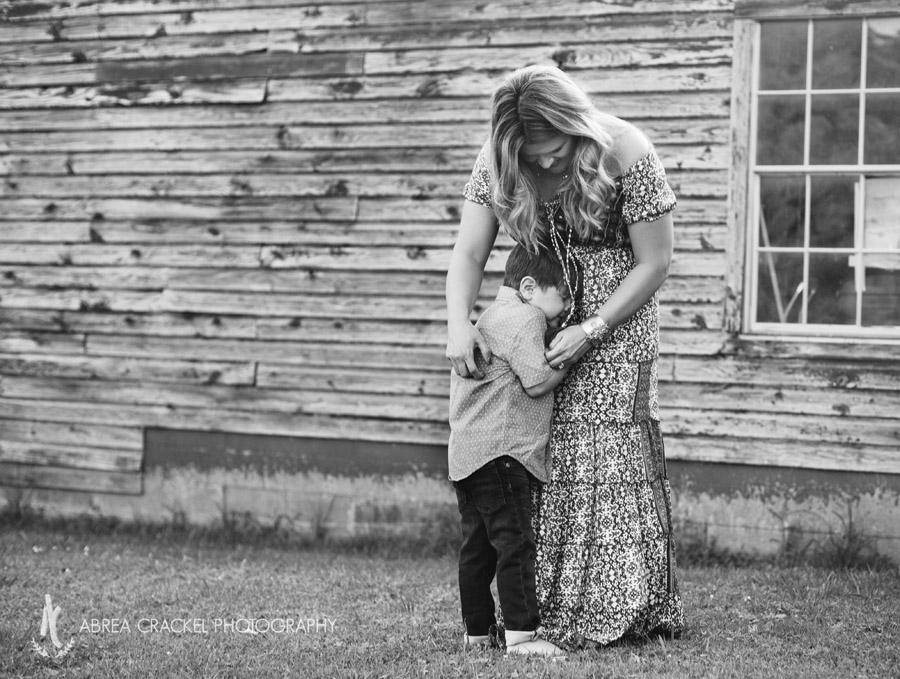 Mother and four-year-old son hugging in black and white