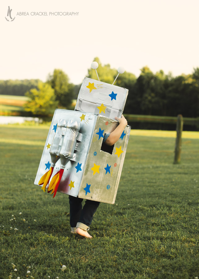 Four year old boy in robot birthday costume
