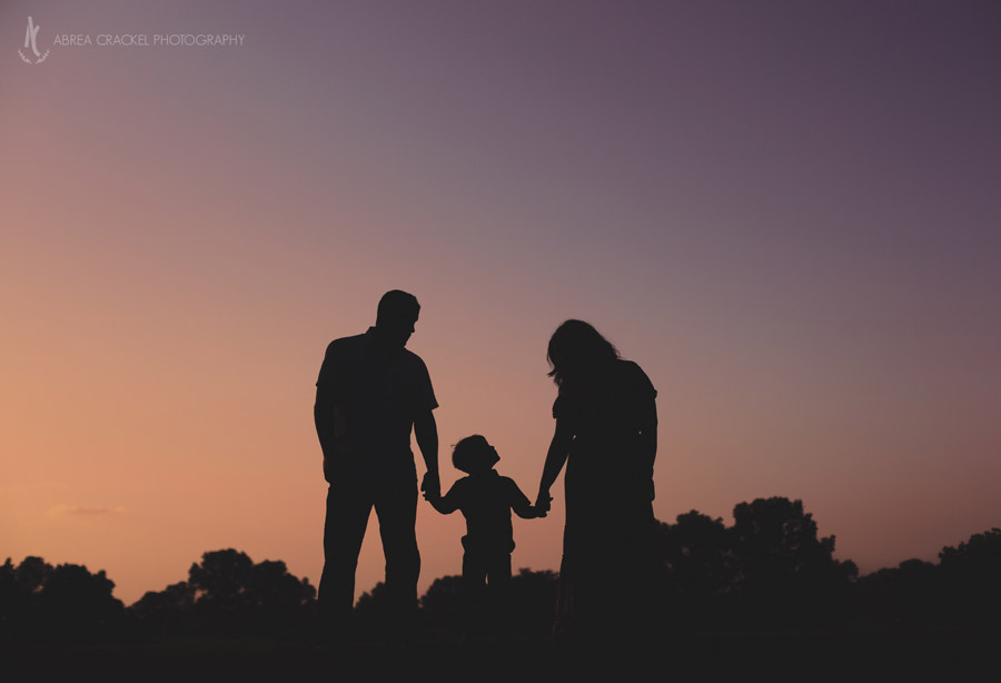 Silhouette of family of three