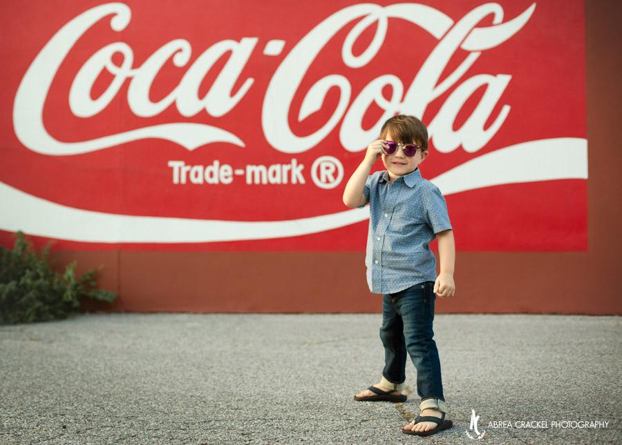 Urban Coca-Cola graffiti behind toddler boy