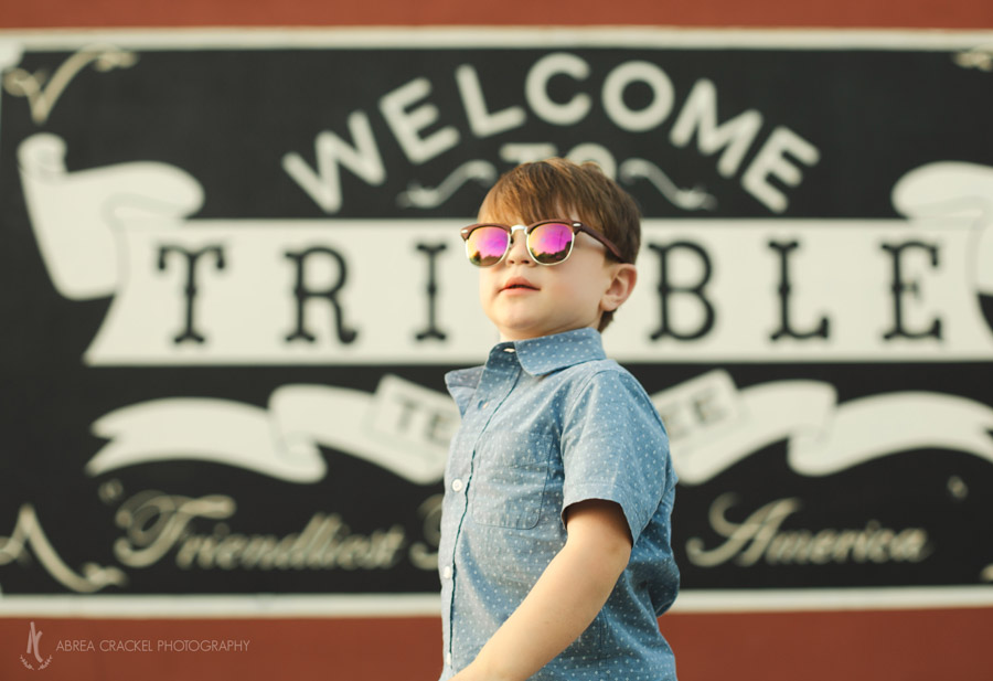 Four year old in front of Welcome to Trimble Tennessee sign