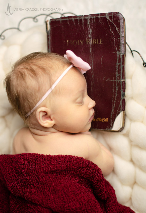 Resting on her dad's Bible
