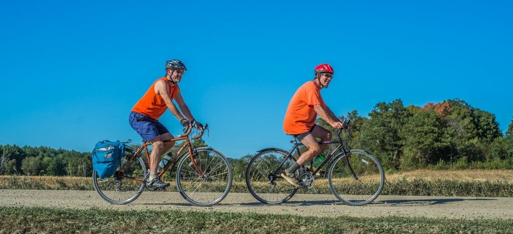 these guys are the epitome of good safety! bright clothing, helmets, single file riding... two thumbs up, orange team!