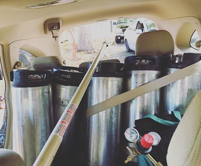 So many drinks for Dyke March. It was a great day and I'm finding all these fun pics like this one of our most precious cargo safely belted in. #pride #berkeley #homebrew