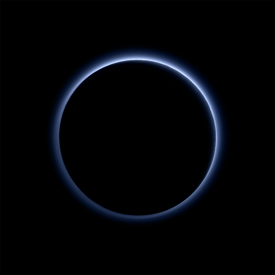Pluto's magnificent blue tinted atmosphere backlit by the Sun!http://www.nasa.gov/image-feature/plutos-blue-sky