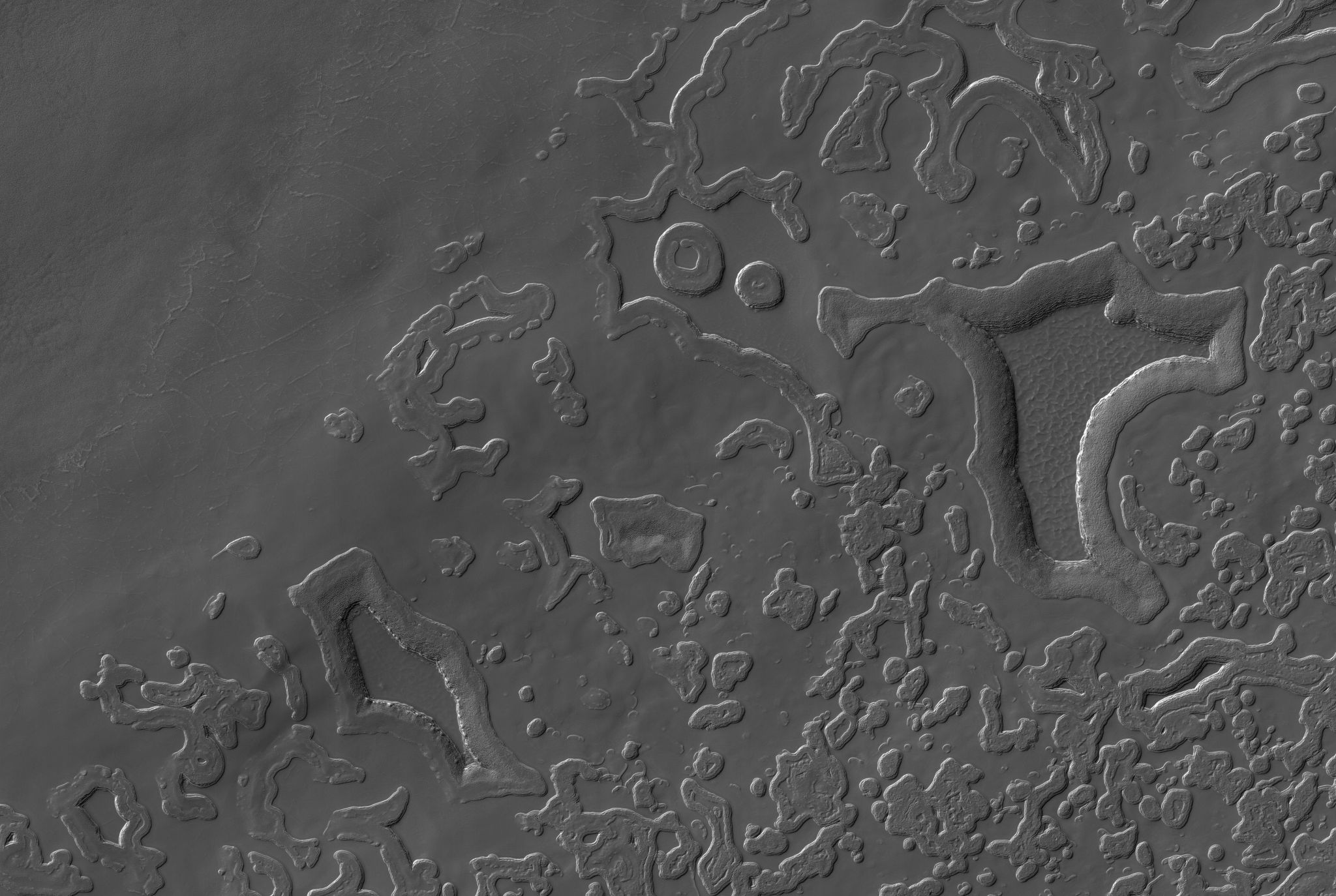 Beautiful water ice cracked floors of the pits and some double-ring features near the top-center of this image. Credit: HiRISE.