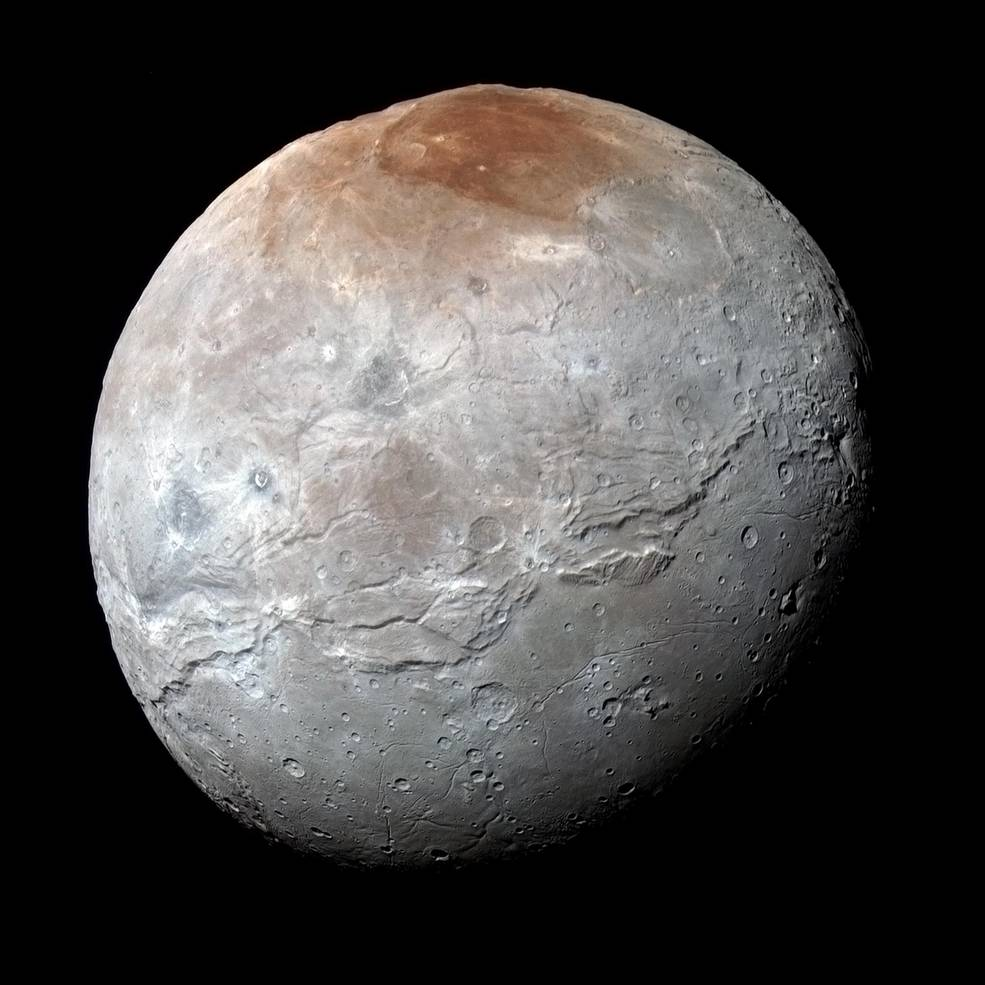 Color-enhanced image of Charon from the New Horizons probe. Notice the dark spot to the north, which is still a mystery of what material this is! Credit: NASA/JHUAPL/SWRI