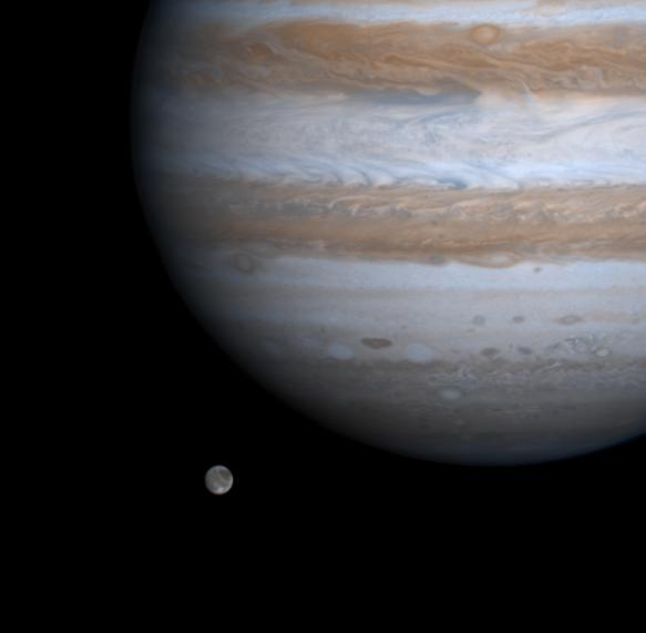 Cassini's fly-by image of Ganymede and Jupiter from 2000 on its way to Saturn. Image credit: NASA/JPL/University of Arizona.
