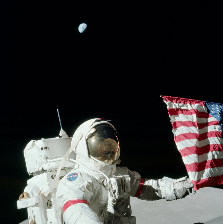 Apollo 17 Astronaut Cernan with the American flag and Earth high above. Credit: The Project Apollo Archive.