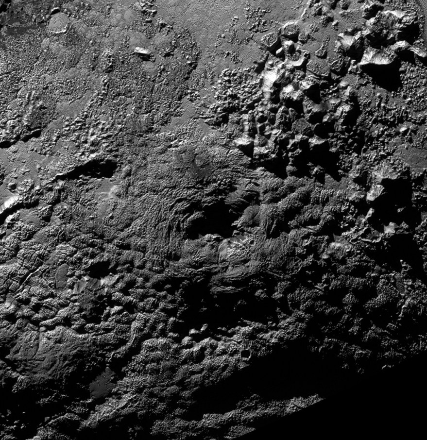 Wright Mons, supposedly a cryovolcano on Pluto. Image credit: NASA/SwRI/JPL.