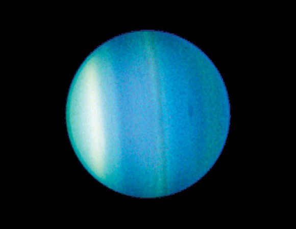 Uranus as seen by the Hubble Space Telescope. Note the cloud bands of different ices! Image credit: NASA/ Hubble.