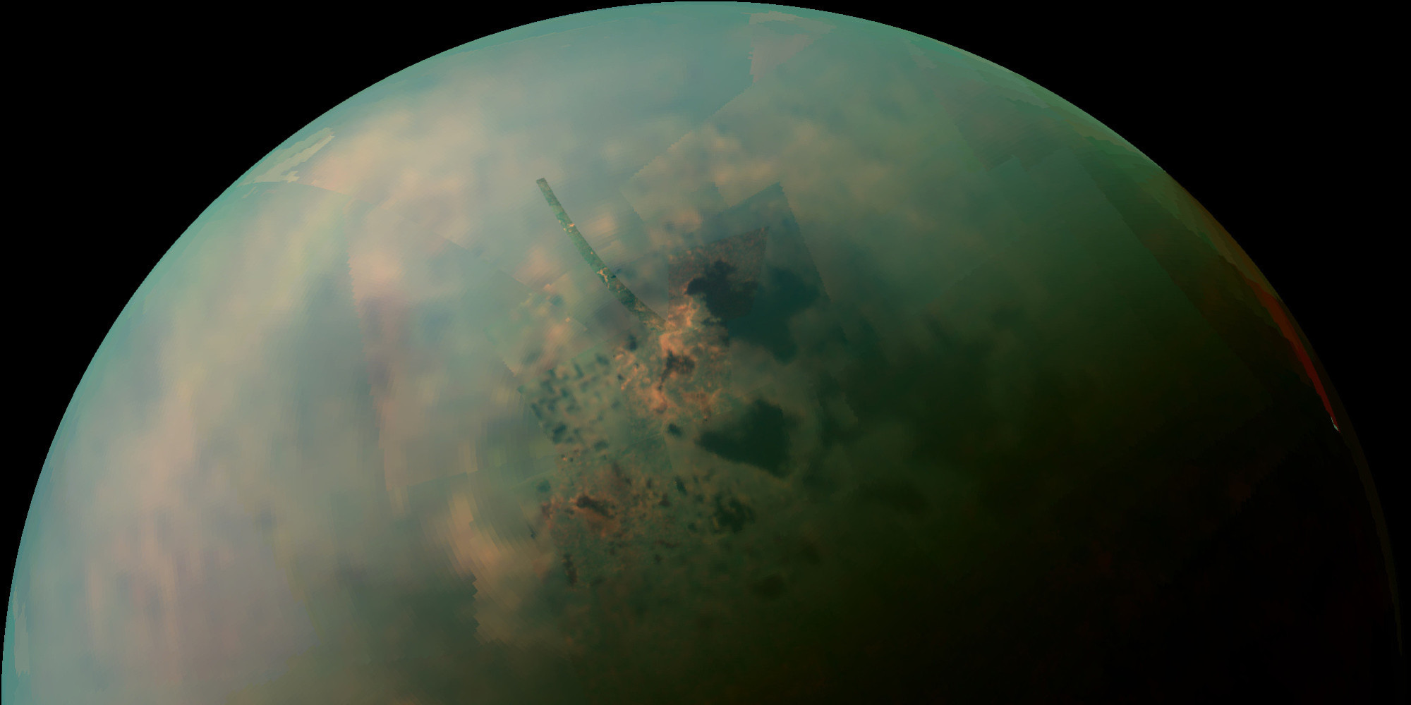 Titan as viewed by Cassini. Darker patches are lake regions. Image credit: NASA/JPL