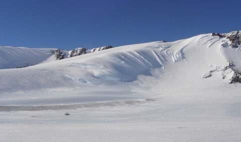 Amazing Antarctic ice mountains! Bottom-center is a skidoo for size reference! Image credit: ANSMET