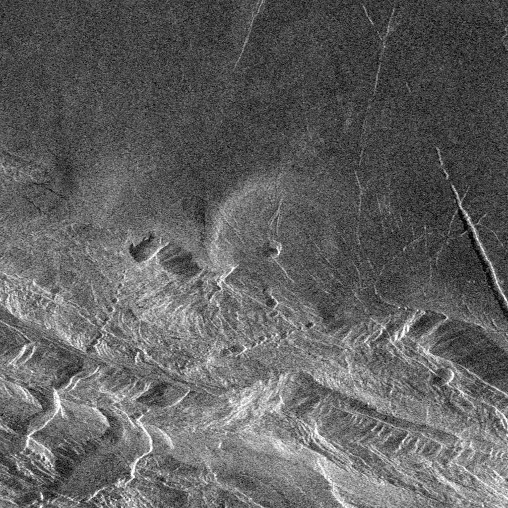 Magellan image of Lakshmi Planitia (north of image) bounded by Danu Montes mountain range (south). Image credit: NASA/JPL