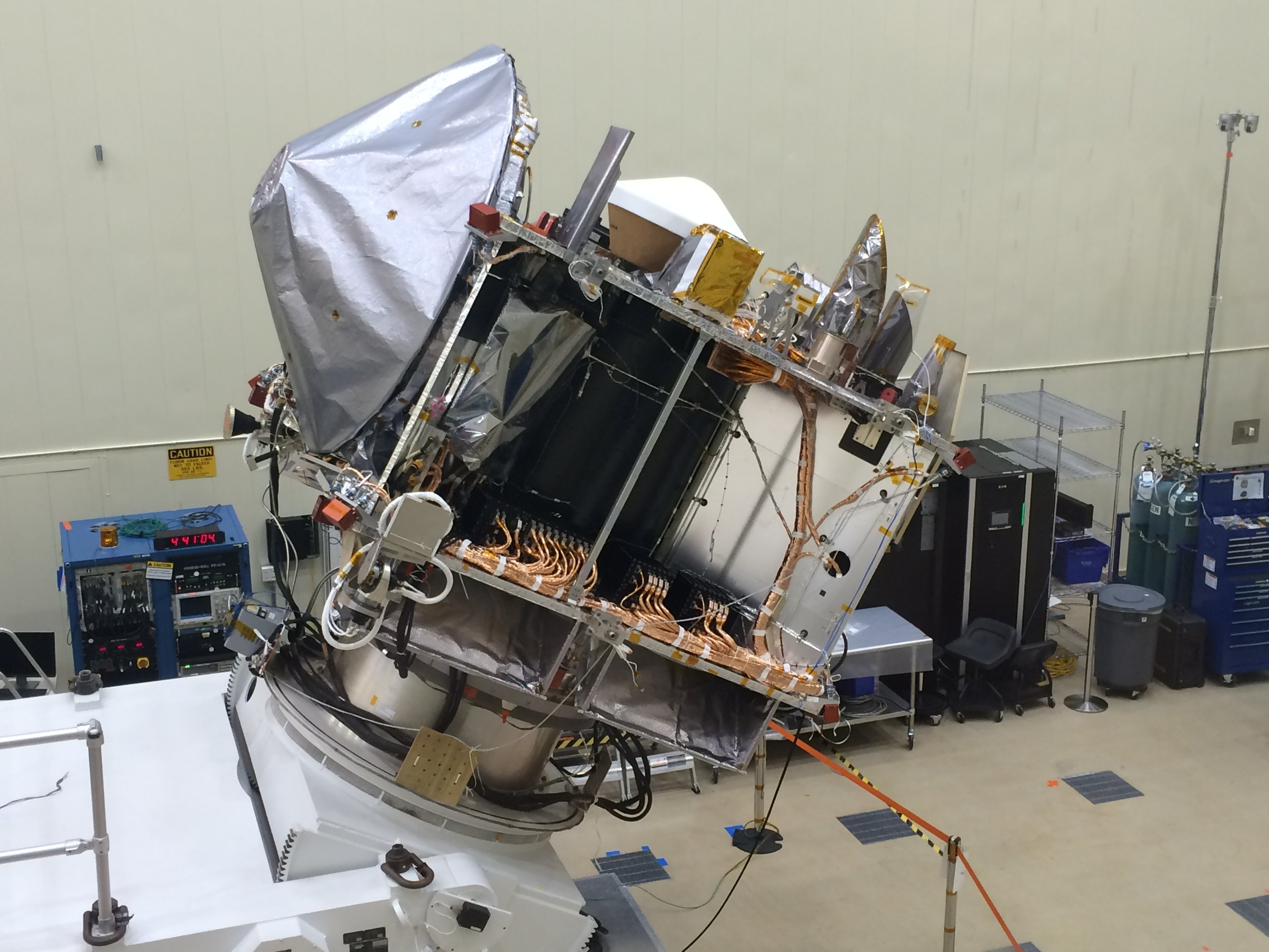 OSIRIS-REx in the clean room at Lockheed Martin in April 2016 after the completion of testing and the final stowage of the TAGSAM arm. Image credit: University of Arizona/Christine Hoekenga