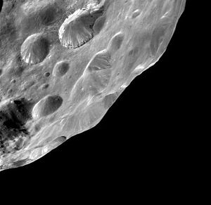 Close-up of the dark-streaked craters of Phoebe as imaged by Cassini. Image Credit: NASA, JPL, VIMS Team, ISS Team, U. Arizona