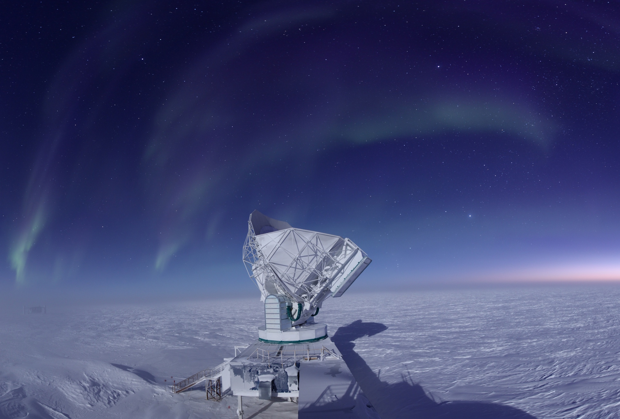 The South Pole Telescope measures the cosmic microwave background! Photo: Jason Gallicchio