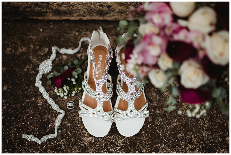 Kayla E. Photography shoes bouquet wedding rings.jpg