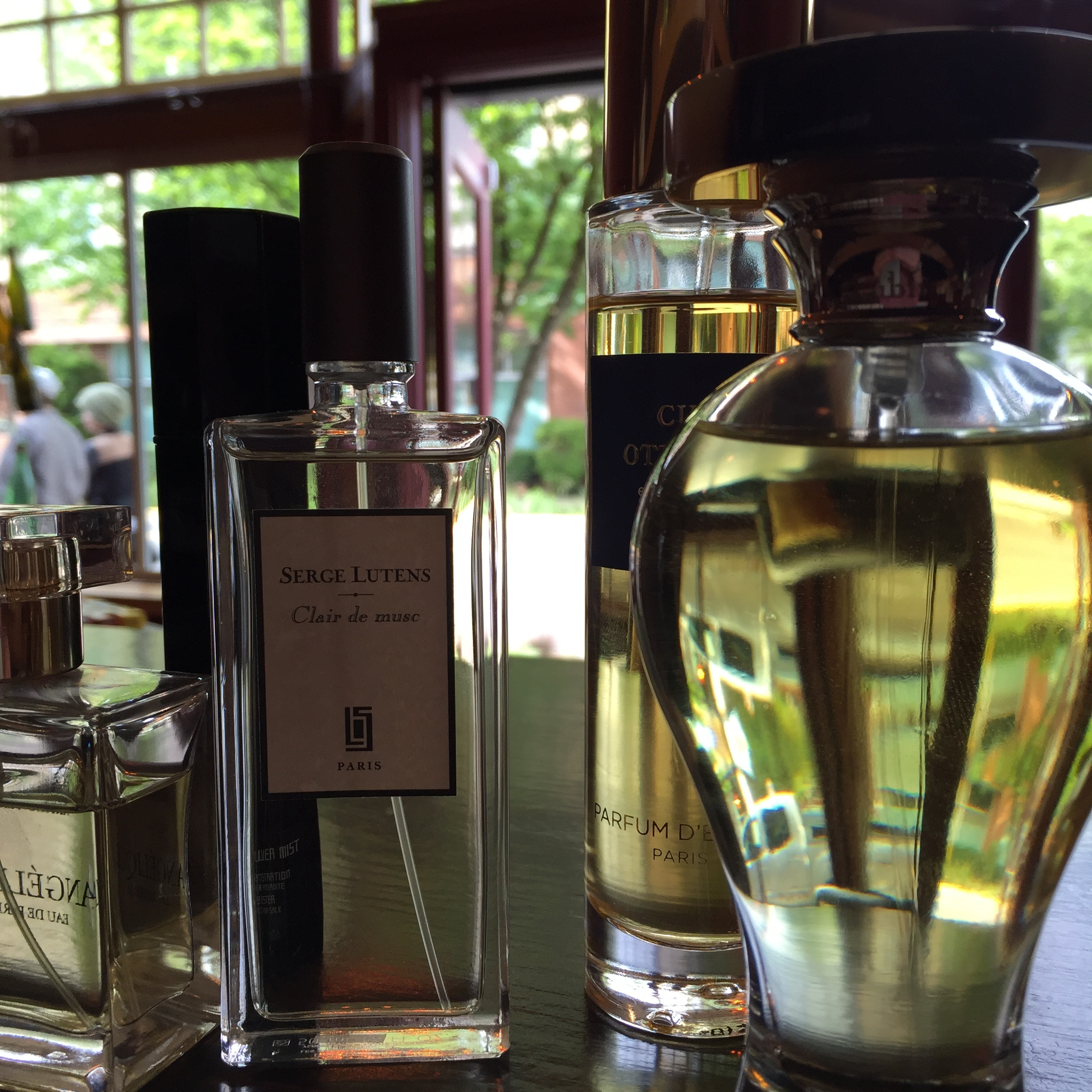 A handful of the fragrances mentioned in this post on the counter at our boutique on SE Division Street in Portland.