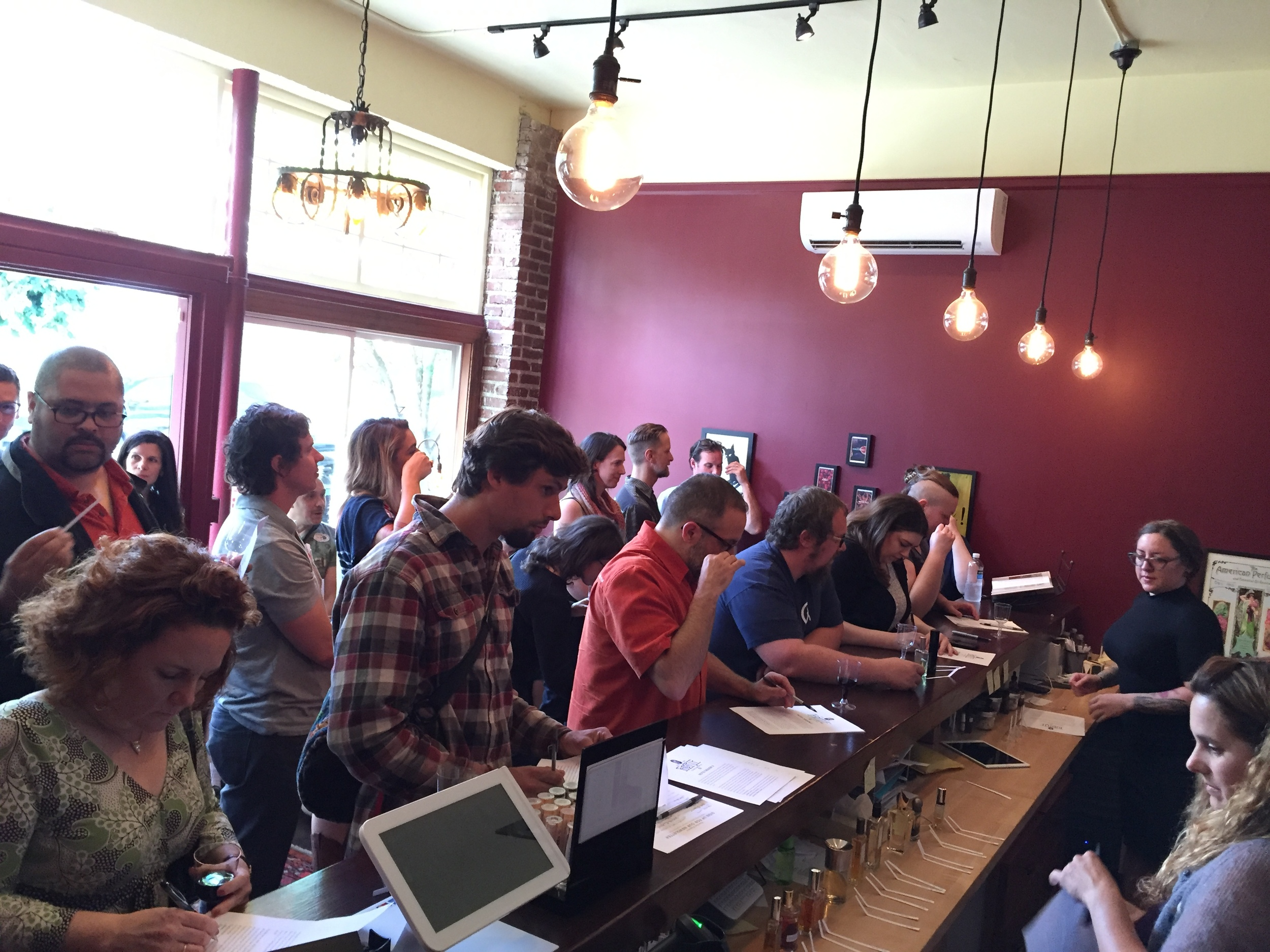 In the foreground attendees record their impressions while Tracy and Nicole look on.