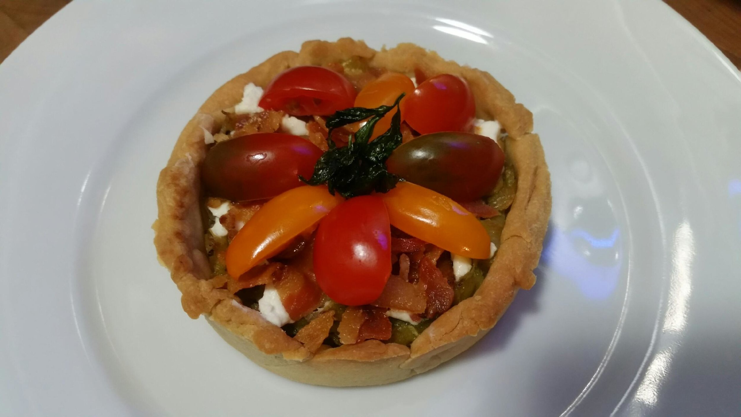 Leek, bacon, goat cheese and tomato  tartlet.