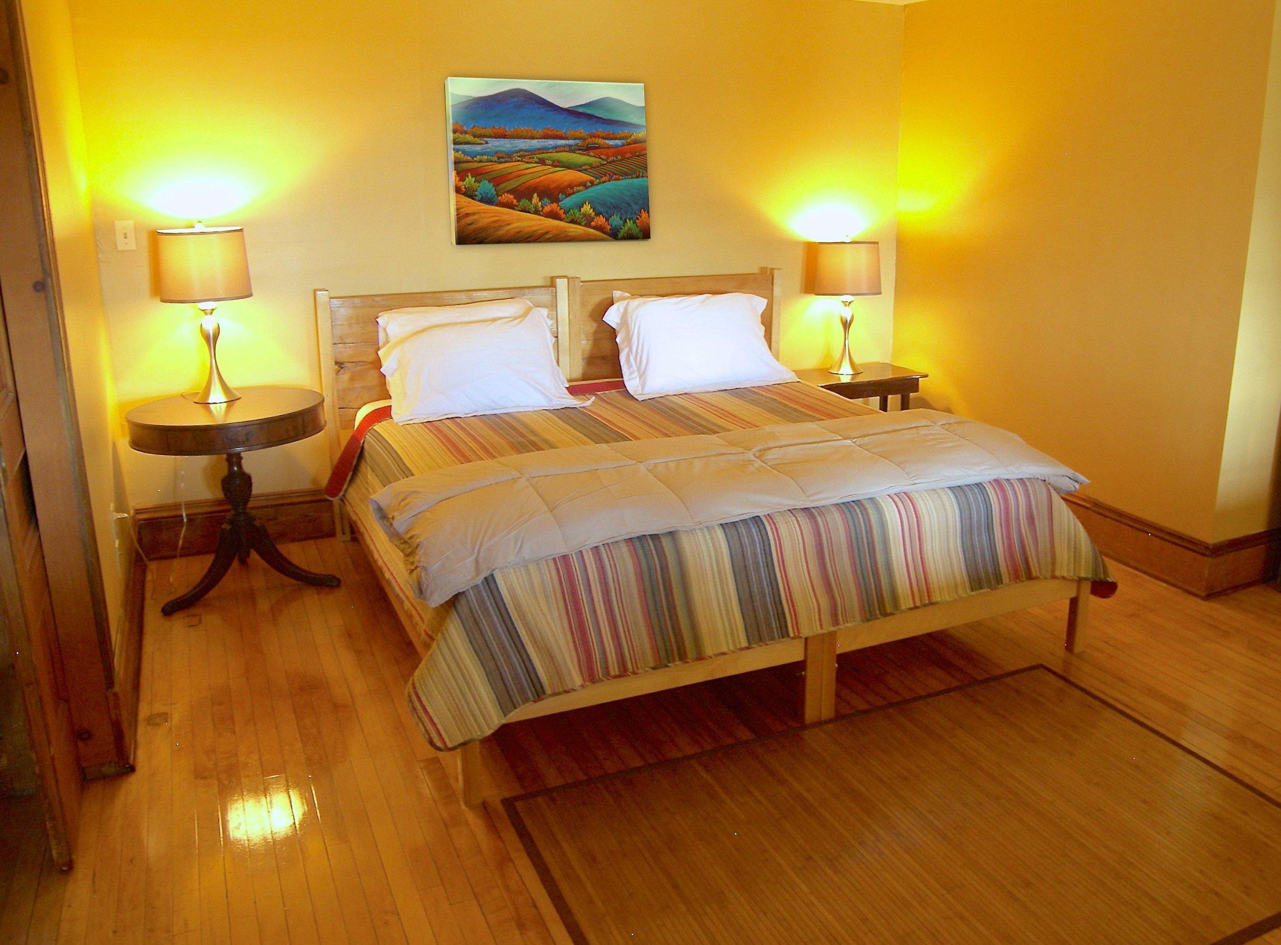 Handmade beds, original hardwood floors and decorative hardware, Vermont artists