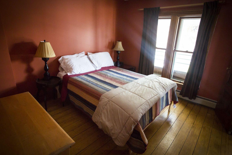 Left Wing South bedroom with handmade queen bed