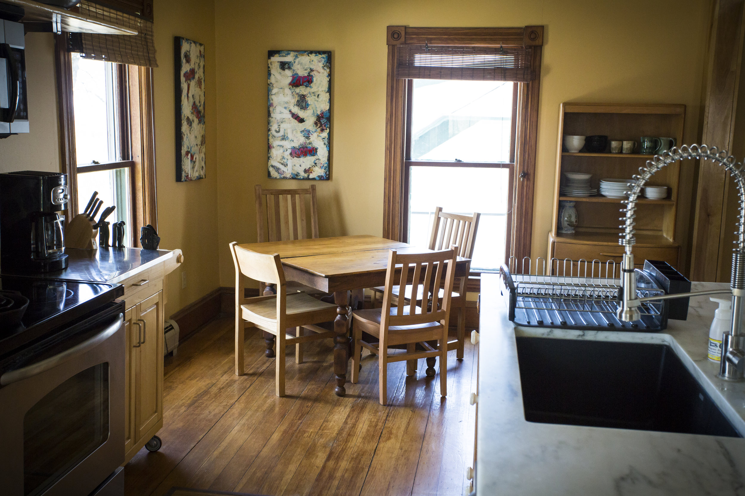 Left Wing kitchen - Spacious and bright dining area, with locally sourced art, solid furniture