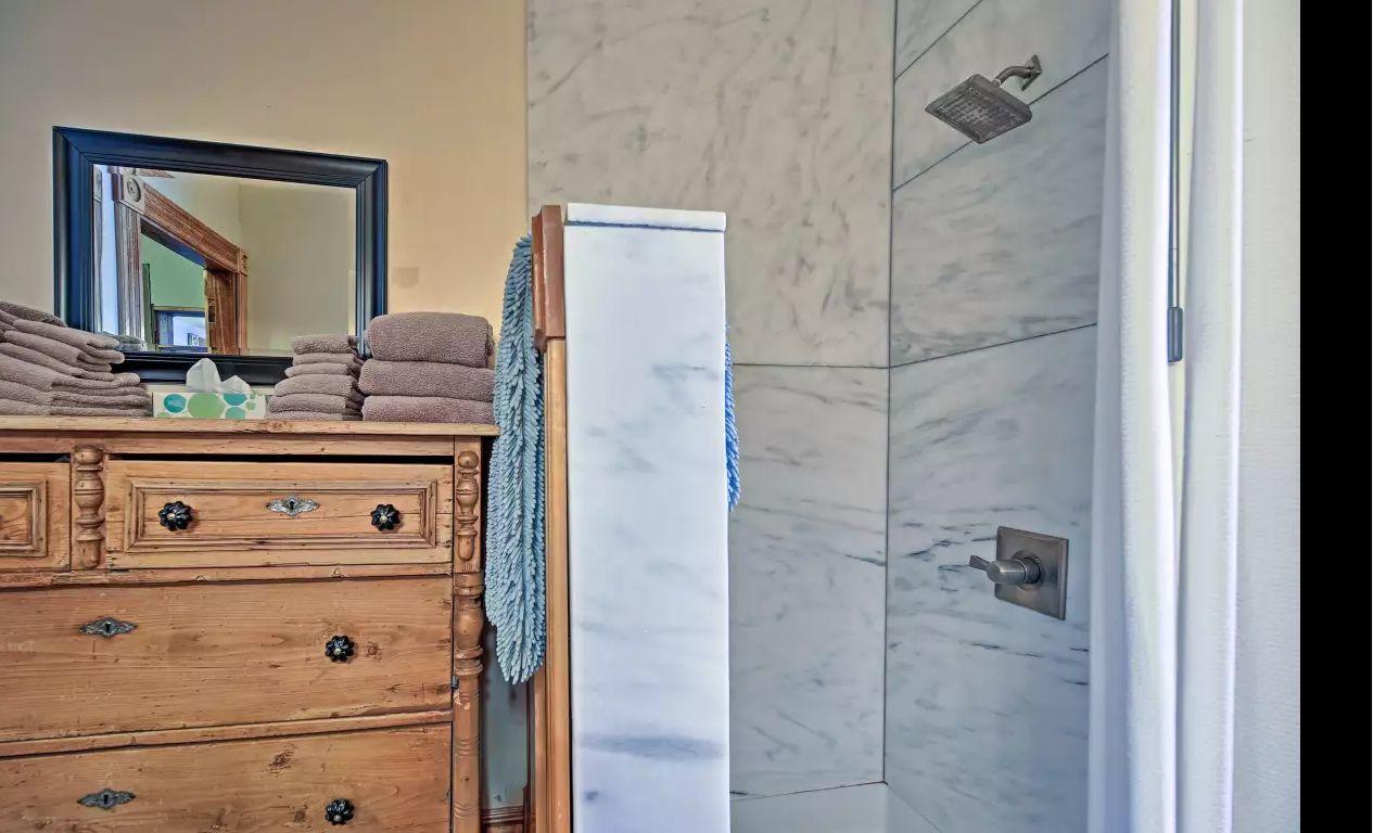 West Wing bathroom - No threshhold spacious walk-in marble shower