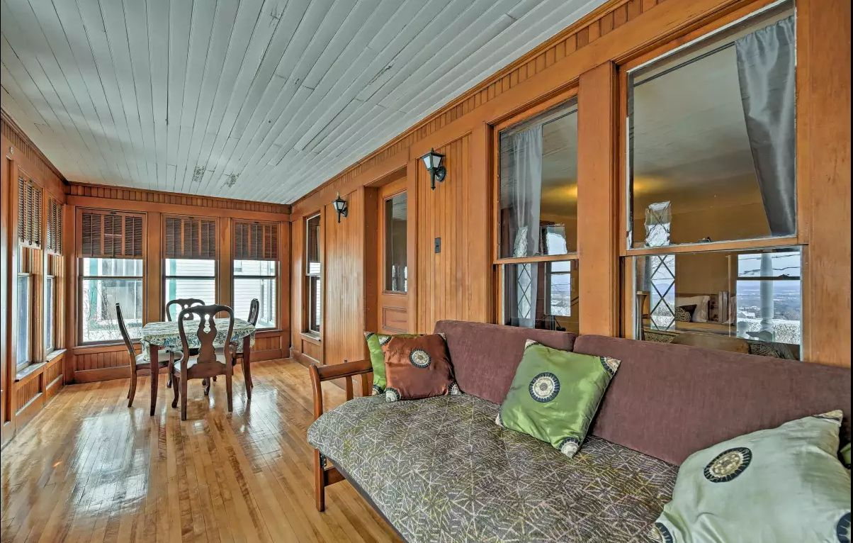West Wing porch - Paneled interior porch with fantastic sunset views of the lake