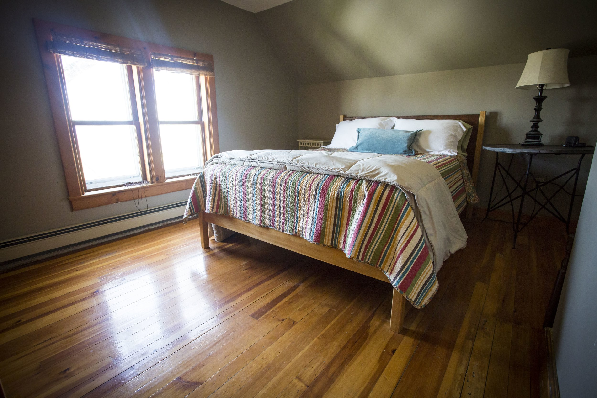 Right Wing upstairs west bedroom - Hardwood floors, handmade bed, fantastic views