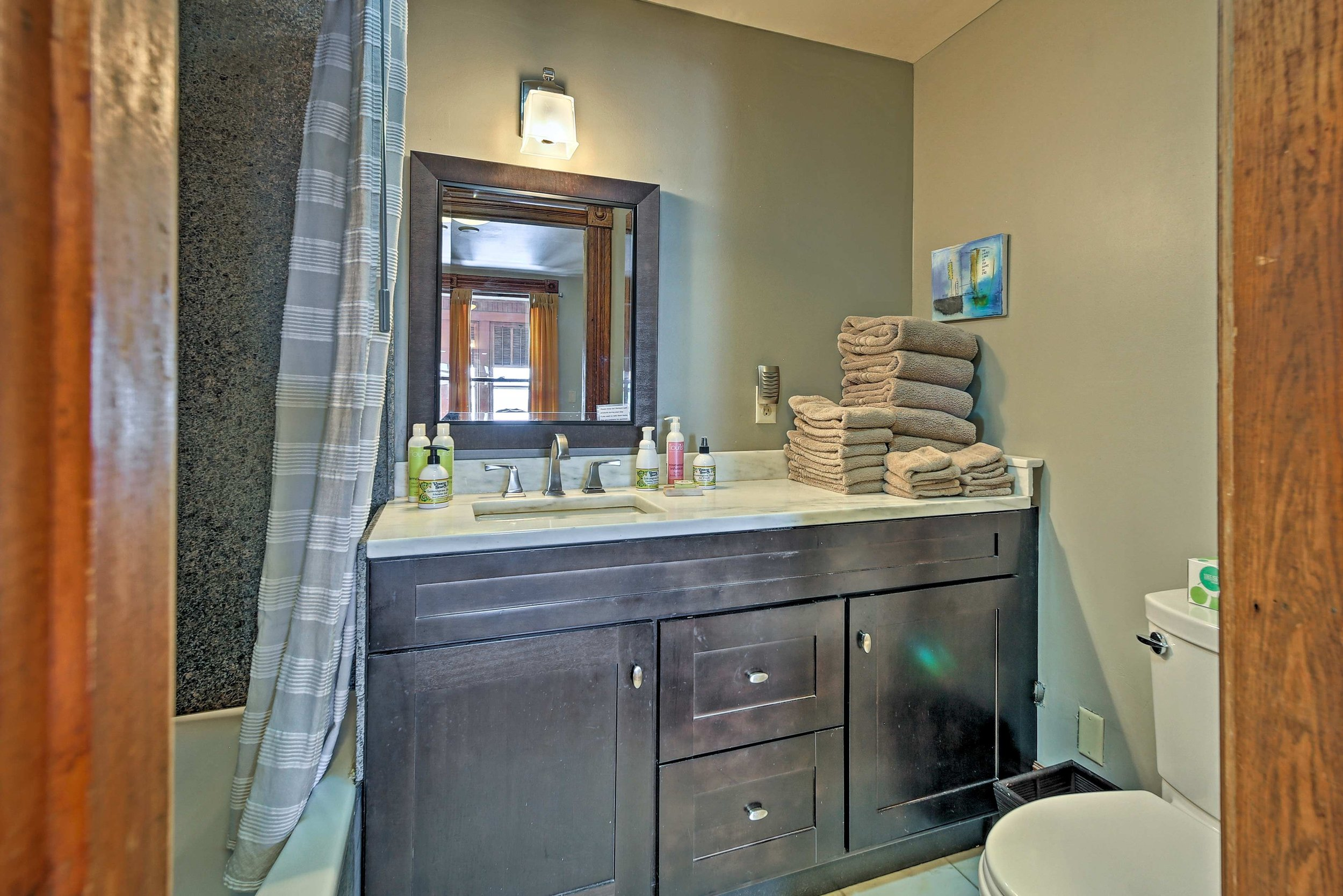 West Wing master bathroom - handcrafted marble counters, marble floors and granite walls