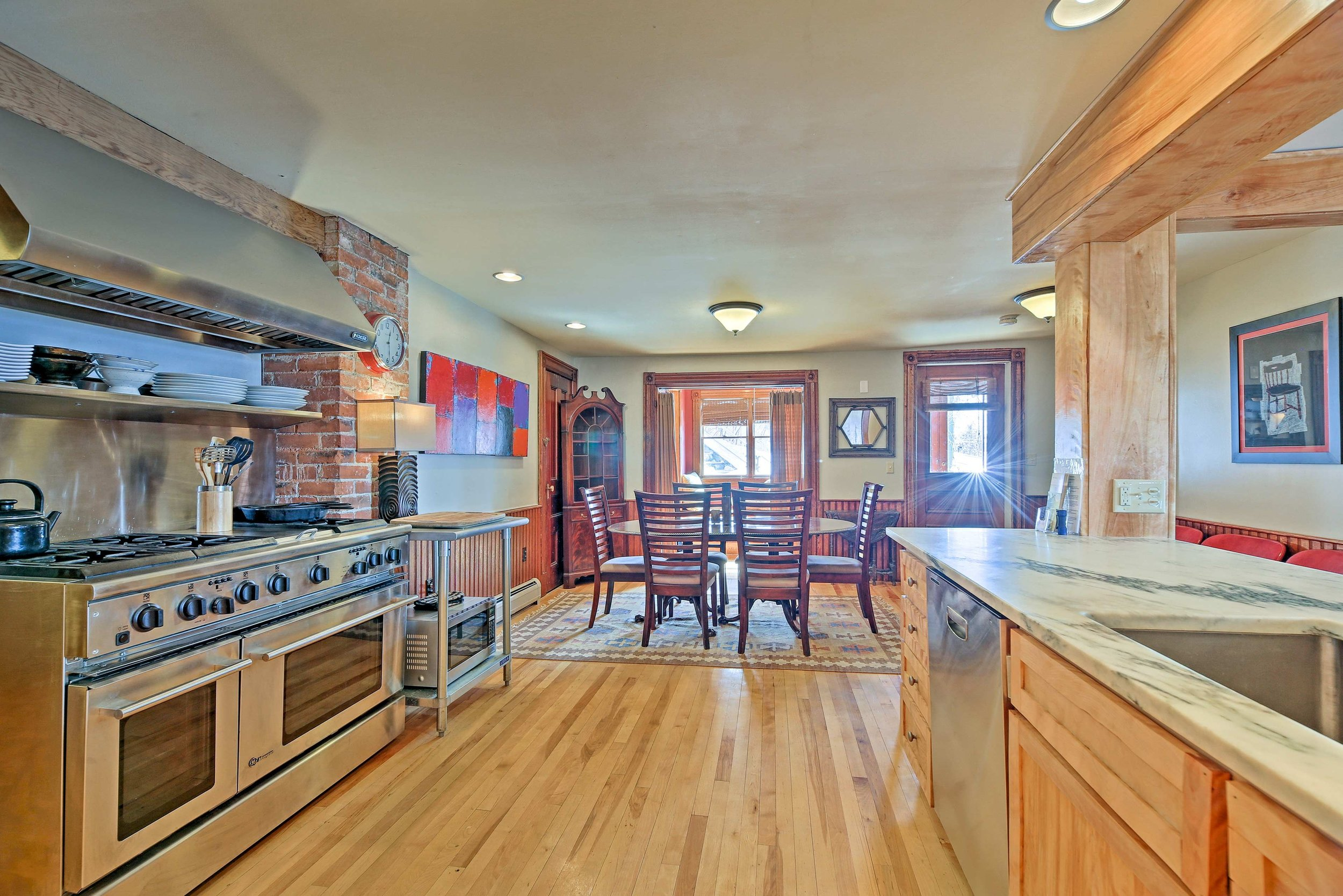 """West Wing kitchen - Warm open spacious kitchen & dining area, 8 burner stove, dual convection ovens, 36"""" refrigerator, dishwasher"""