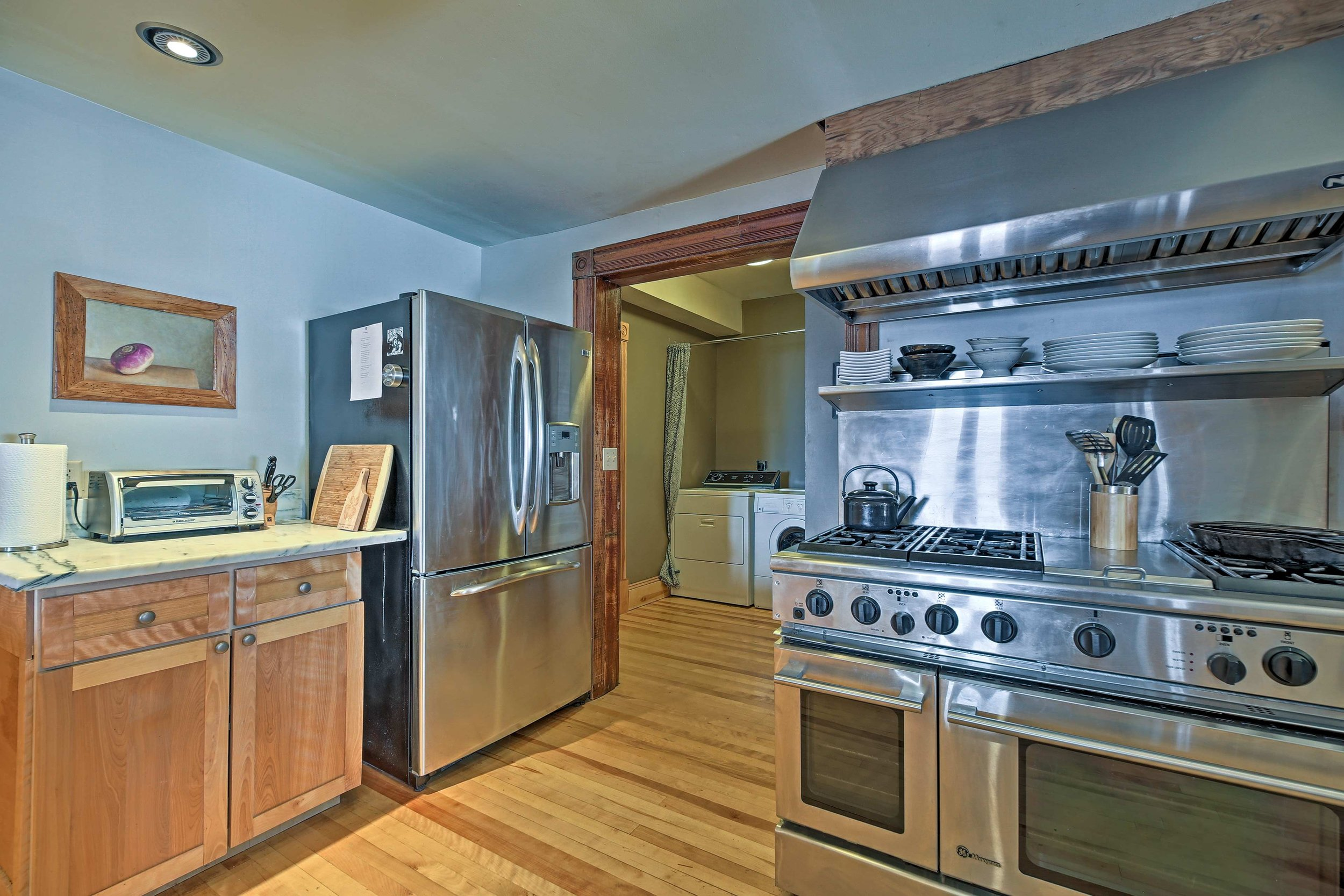 """A complete kitchen: Quality stainless appliances: 8 burner gas stove with hood, electric convection oven, 36"""" refrigerator, dishwasher, walk-in pantry, deep sink, 10 foot marble counter"""