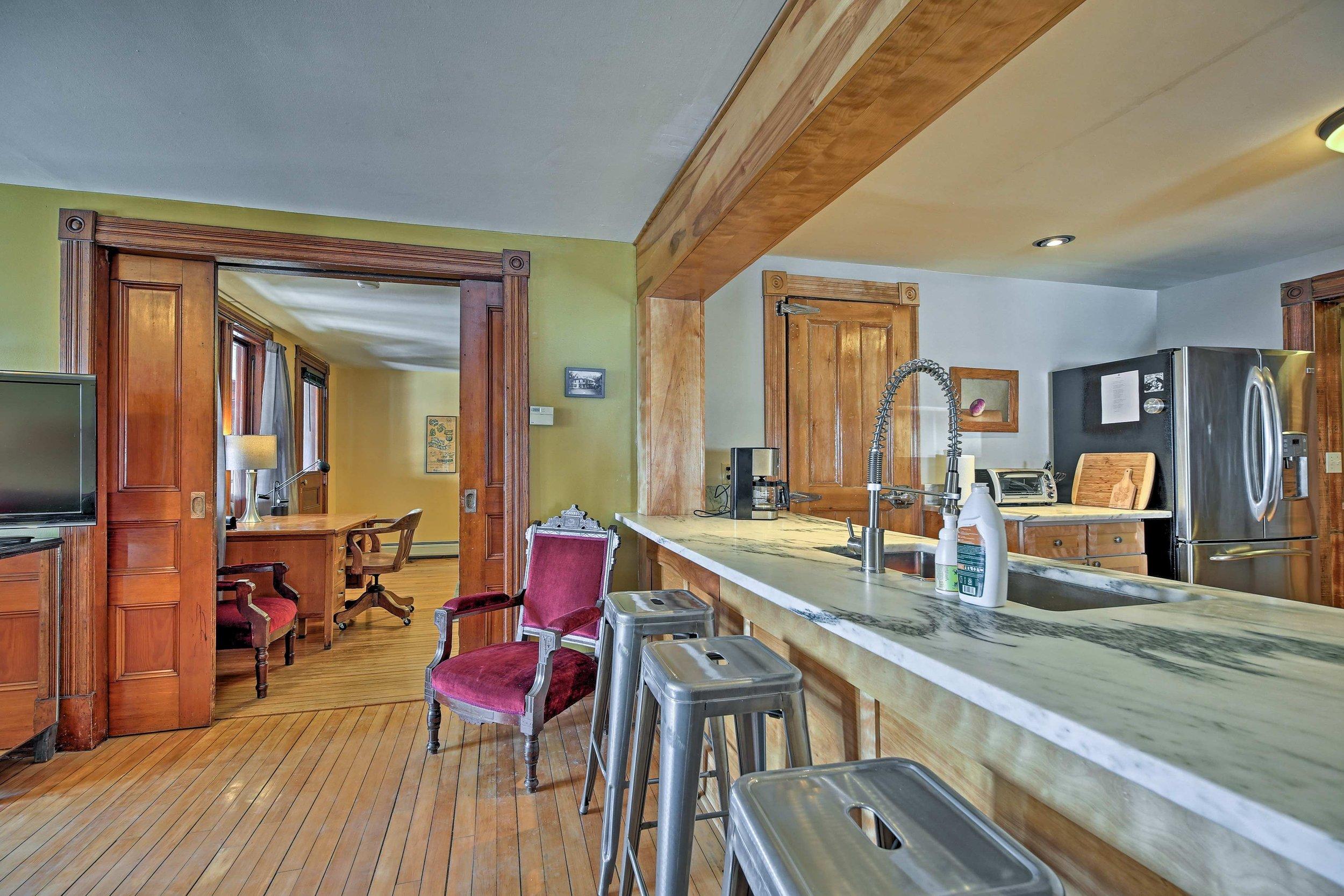 West Wing living room - Huge Danby, Vermont marble counter, 3 sets of original double pocket doors