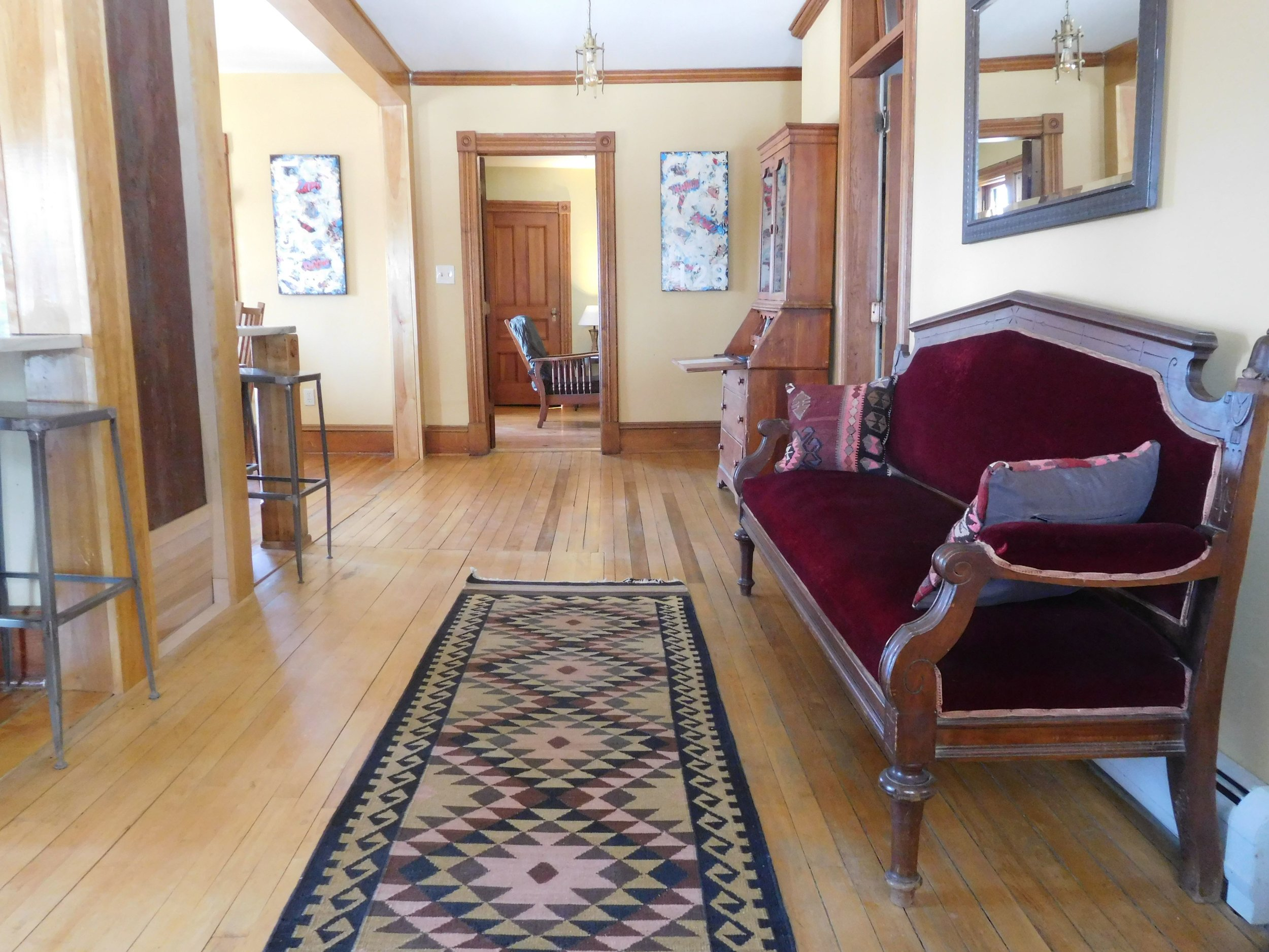 Left Wing entry - Hardwood floors, locally sourced art, quality furniture.