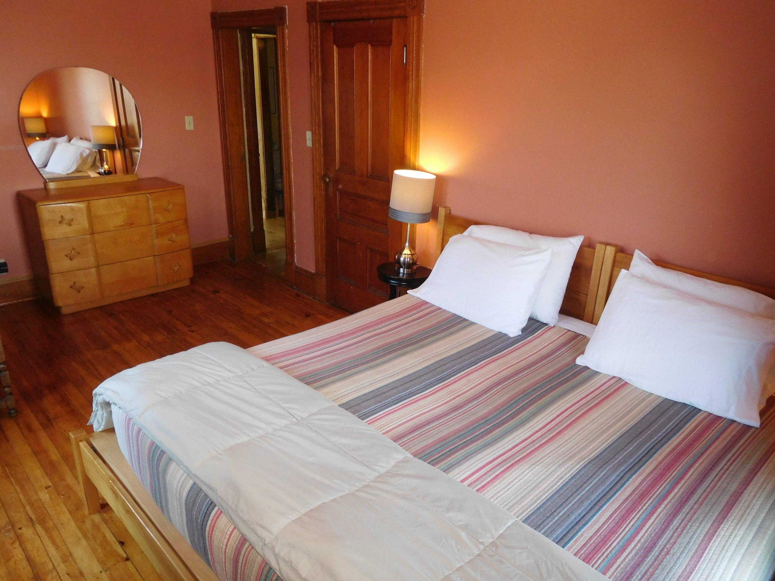 Left Wing master bedroom - hardwood floor, handmade bed,