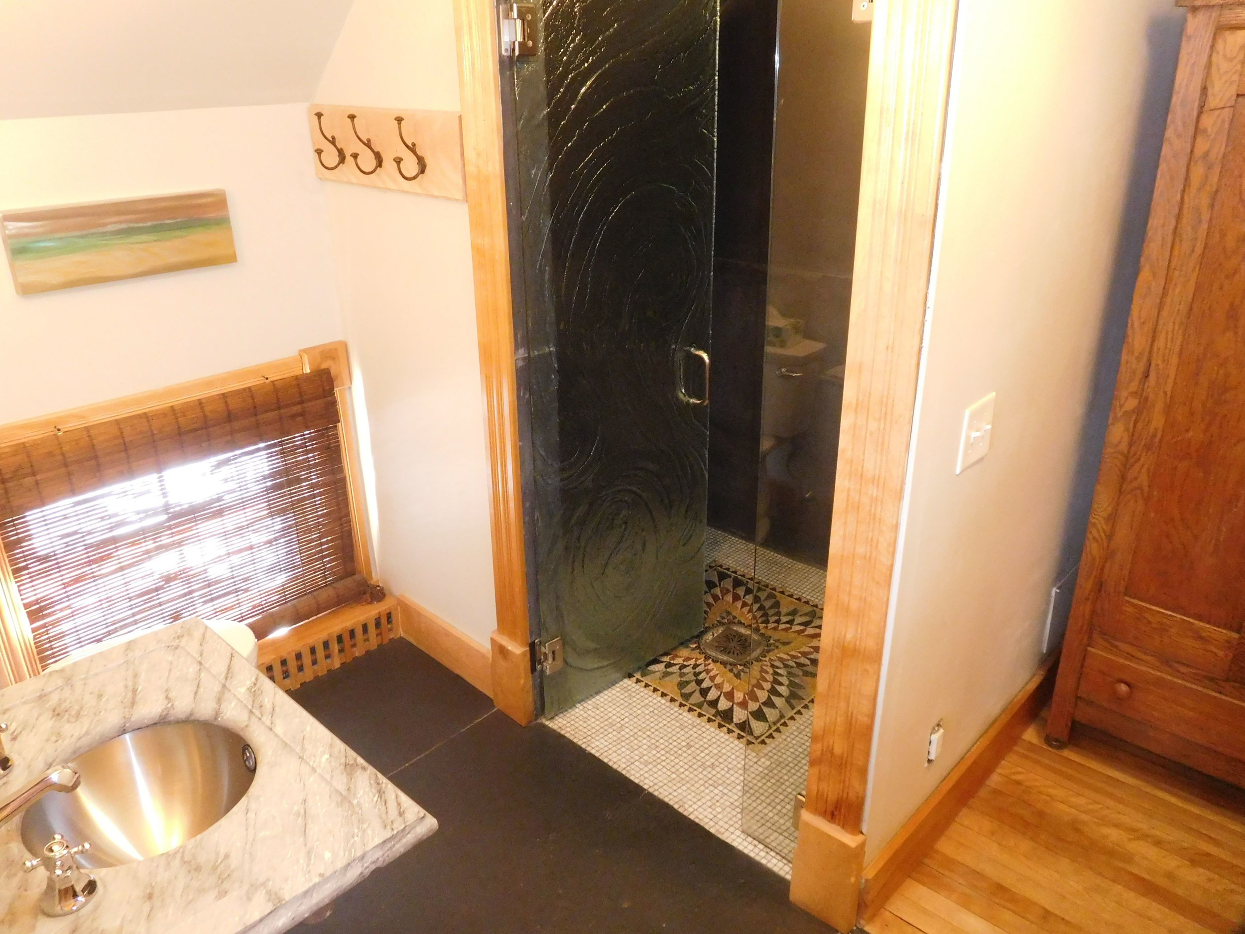 Carriage House downstairs bathroom. Steam shower, mosaic tiled floor, pressed glass door