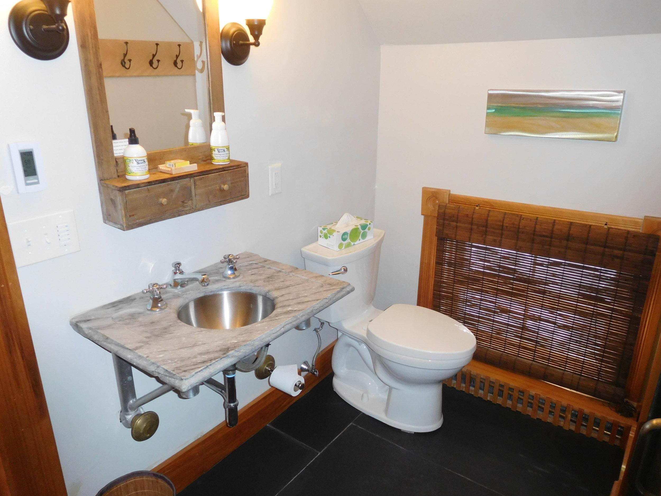 Carriage House downstairs bathroom, marble sink slate floor