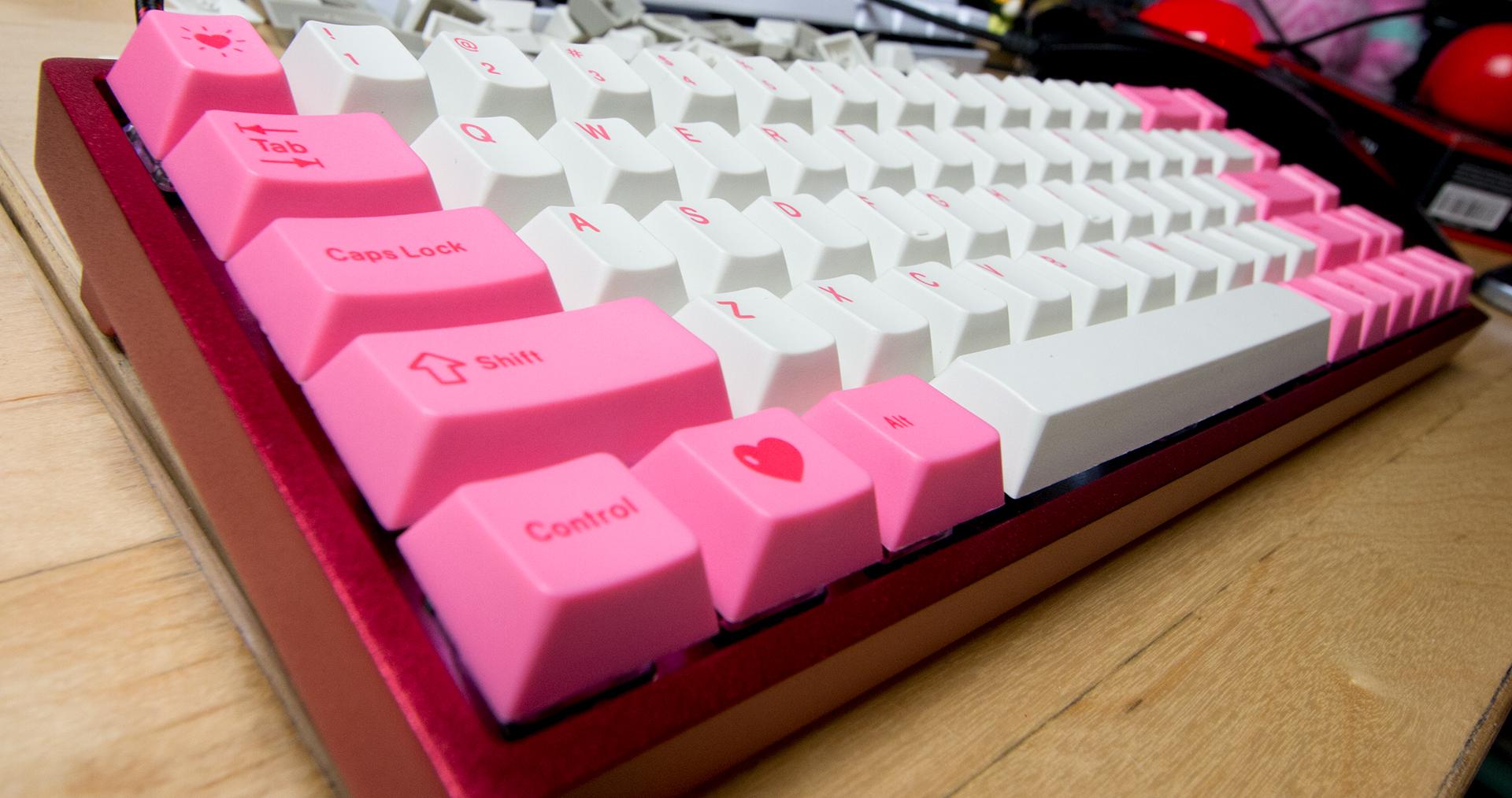 Pink & White Heart Keyboard  https://www.kotaku.com.au/2017/05/swapping-keycaps-is-the-key-to-having-a-pretty-keyboard/